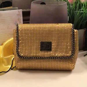 Chain trimmed gold clutch